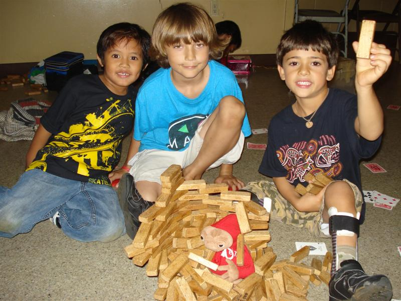 photo of children playing with building blocks