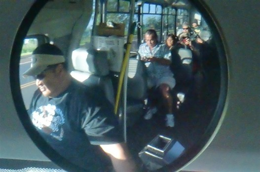 photo of bus driver's rear view mirror