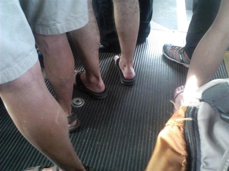 photo of legs and feet on a bus